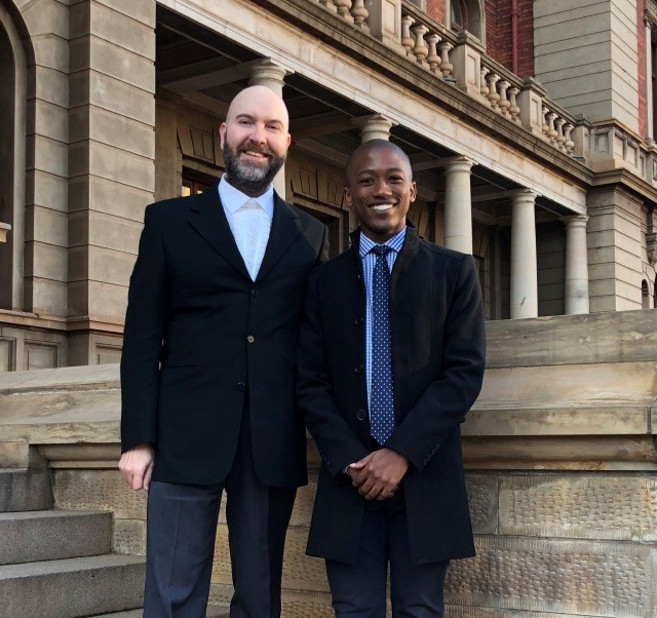 Mr Bonginkosi Shozi (right) and Dr Donrich Thaldar, on the steps of the Palace of Justice in Pretoria.